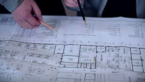 Group engineers and architects discuss the blueprint. stock video