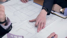 Group engineers and architects discuss the blueprint. stock video footage