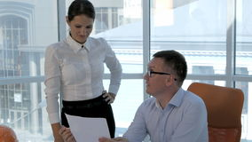 Group engineers and architects discuss the blueprint in modern bright office. stock footage