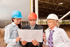 Group of engineers  at construction site Stock Images