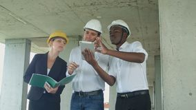Group of engineers and experts discuss about construction site stock footage