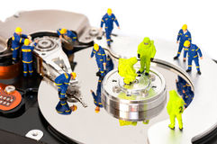 Group of engineers maintaining hard drive Stock Photos