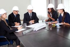Group of engineers working together Stock Photo