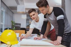 Group of engineers working together at the office royalty free stock image