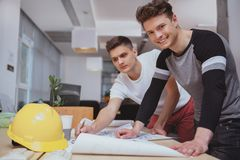 Group of engineers working together at the office stock photos