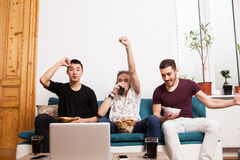 Group of enthusiasts friends watching a game Royalty Free Stock Images