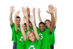 Group of environmental activists raising arms Stock Photo