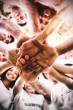 Group of environmentalists stacking hands Stock Photo