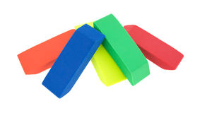 Group of erasers on a white background. Orange, blue, yellow, green and red erasers arranged on a white background Royalty Free Stock Photography