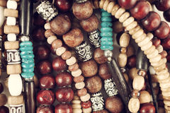 Group of Ethnic wooden bracelets and necklaces. Close-up Royalty Free Stock Image