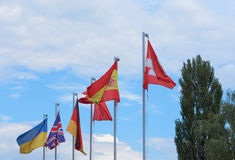 A group of european country flags against blue sky royalty free stock photo