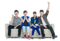 Excited teens. Group of excited friend team on the sofa isolated Royalty Free Stock Images