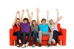 Group of excited friends. Young friends with arms raised in success Royalty Free Stock Image