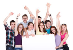 Group of excited friends holding a banner royalty free stock photos