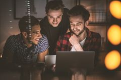 Group of excited friends watching photos on a tablet together. Concept Royalty Free Stock Image
