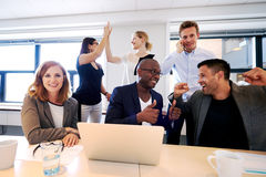 Group of executives celebrating. Group of executives gathered in conference celebrating royalty free stock photography