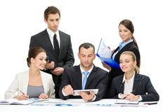 Group of executives discussing Stock Images
