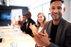 Group of executives facing camera and clapping Stock Images