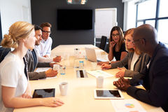 Group of executives having meeting in conference room. Group of young executives holding a work meeting in a conference room royalty free stock photo