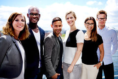 Group of executives posing outside for picture Royalty Free Stock Images