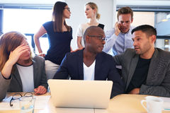 Group of executives sitting working intensely royalty free stock images