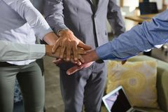 Group of executives stacking hands over each other. In the office royalty free stock photos