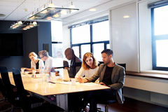 Group of executives working in conference room Royalty Free Stock Photography