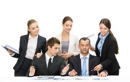 Group of executives working. While sitting at the table, isolated on white. Concept of teamwork and cooperation stock photography