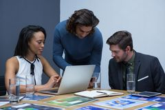 Group of executives working together on project Royalty Free Stock Images