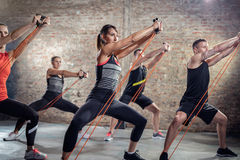 Group exercising with elastic band Royalty Free Stock Photography
