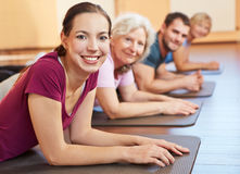 Group exercising in gym Stock Photos