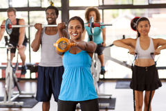 Group exercising in a gym. Multi-ethnic gym class doing various exercises Royalty Free Stock Photography
