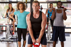 Group exercising in a gym. Multi-ethnic gym class doing various exercises Royalty Free Stock Photos