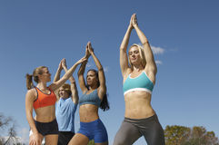 Group Exercising With Instructor In Park Royalty Free Stock Photography