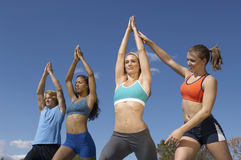 Group Exercising With Instructor In Park Stock Photo