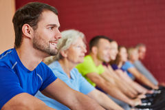 Group exercising in spinning class Stock Photo