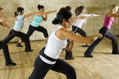 Group of exercising women stock image