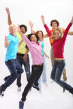 Group of exited young people jumping Stock Images