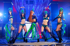 Group of exotic dancers wearing colorful stage carnival outfits Royalty Free Stock Photos