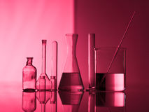 Group of experimental glassware on a table stock photo