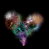 A group of exploding fireworks shaped like a heart. Stock Images