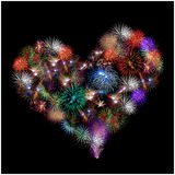 A group of exploding fireworks shaped like a heart. Royalty Free Stock Photography