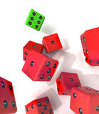 Group of falling red dices with one winning green Stock Photos