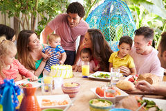 Group Of Families Celebrating Child's Birthday At Home Royalty Free Stock Photography