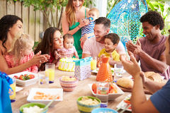 Group Of Families Celebrating Child's Birthday At Home Royalty Free Stock Images