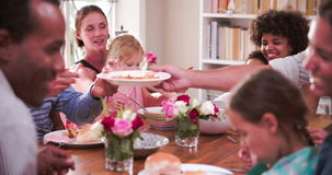 Group Of Families Having Meal At Home Together. Group of friends at home sitting with their children eating meal. Shot in 4k on Sony FS700 at frame rate of 25fps stock footage