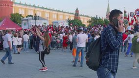 Moscow - Circa June, 2018: Group of Fan from Tunisia On Manezhnaya square in Mosocw. Group of Fan from Tunisia On Manezhnaya square stock footage