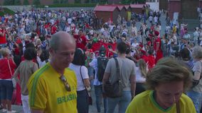 Moscow - Circa June, 2018: Group of Fan from Tunisia On Manezhnaya square in Mosocw. Group of Fan from Tunisia On Manezhnaya square stock video footage