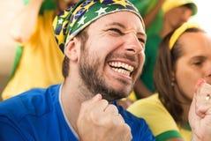 Brazilian supporters at stadium bleachers. stock photos