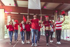 Group of fans dressed in red color Stock Images